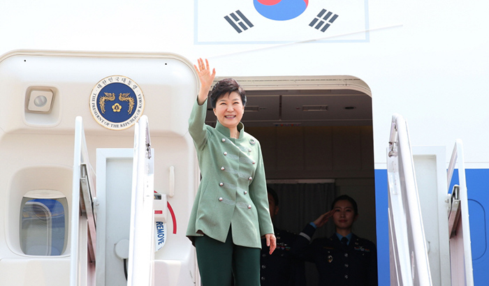 President Park Geun-hye waves as she departs the Seoul Air Base on May 1 to begin her state visit to Iran.