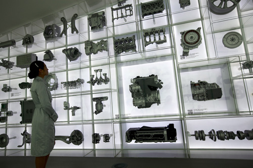 An exhibit at the Hyundai Motor Pavilion showcases models of Hyundai vehicles and vehicle parts that have been produced over the years