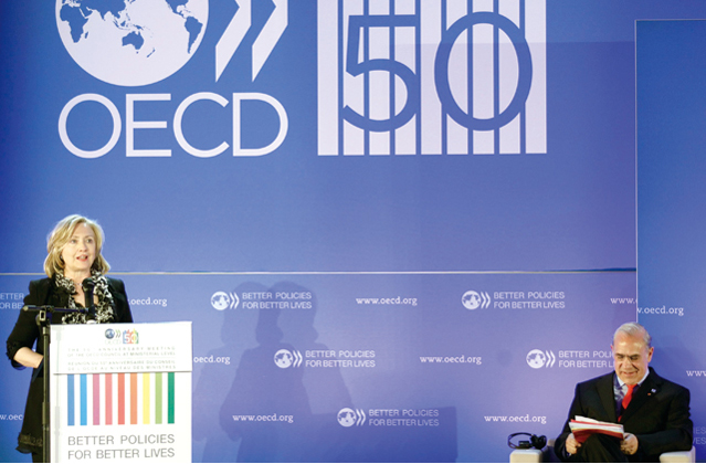 US Secretary of State Hillary Clinton gives a speech during the OECD's 50th Anniversary Forum held on May 25, 2011 in Paris, France. On the same day, the OECD adopted Korea's Green Growth Declaration.