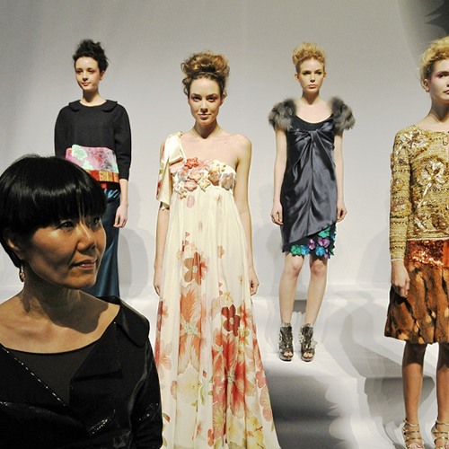 Korean designer Son Jung Wan(left) in front of her designs, on display at the Concept Korea FW 12 presentation show on February 10 (photo courtesy of the Korea Creative Content Agency).