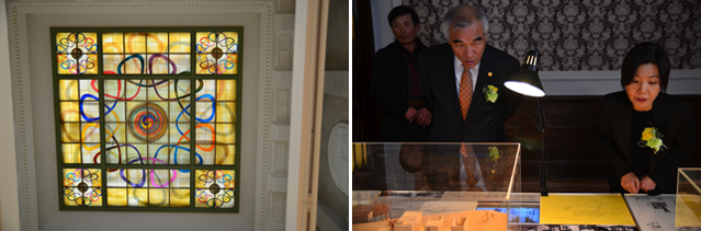 The stained-glass ceiling in the central hall of the building (left); Minister Choe Kwang Shik appreciates some art pieces (right).