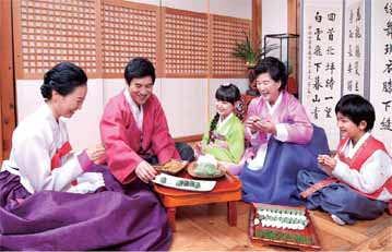 A family making songpyeon, half moon-shaped rice cakes, for Chuseok