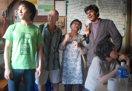 "Stephen Epstein (middle left) arranged for a screening of ""Our Nation"" in 2011, where he met Bamseom Pirates guitarist Jang Pyha (left), Korean film studies scholar Kim Soyoung (middle right), and Mahbub Alamm, star of Bandhobi, a director, actor, and migrant activist (right)."