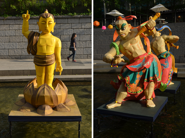 Figures at Cheonggyecheon depict Buddha (left) and temple guardians (right).