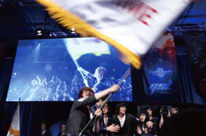 Lee Jung-hoon holds the team flag after winning at the GSTL finals in Las Vegas