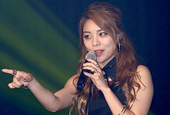 Ailee poses with Beyonce′s producer as preparations for...